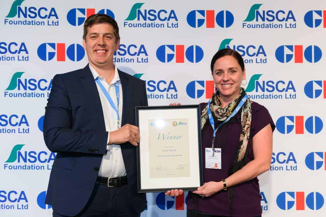 FSA Non-Executive Chairman Steve McLeod with recipient Natalie
